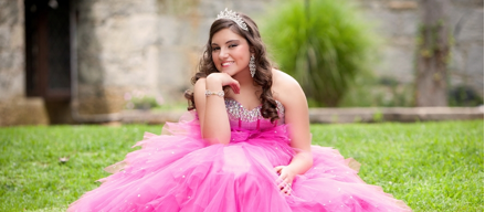 A quinceañera photo of a young lady in a dress