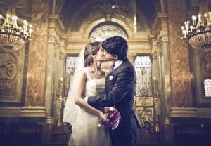 husband kissing bride in church