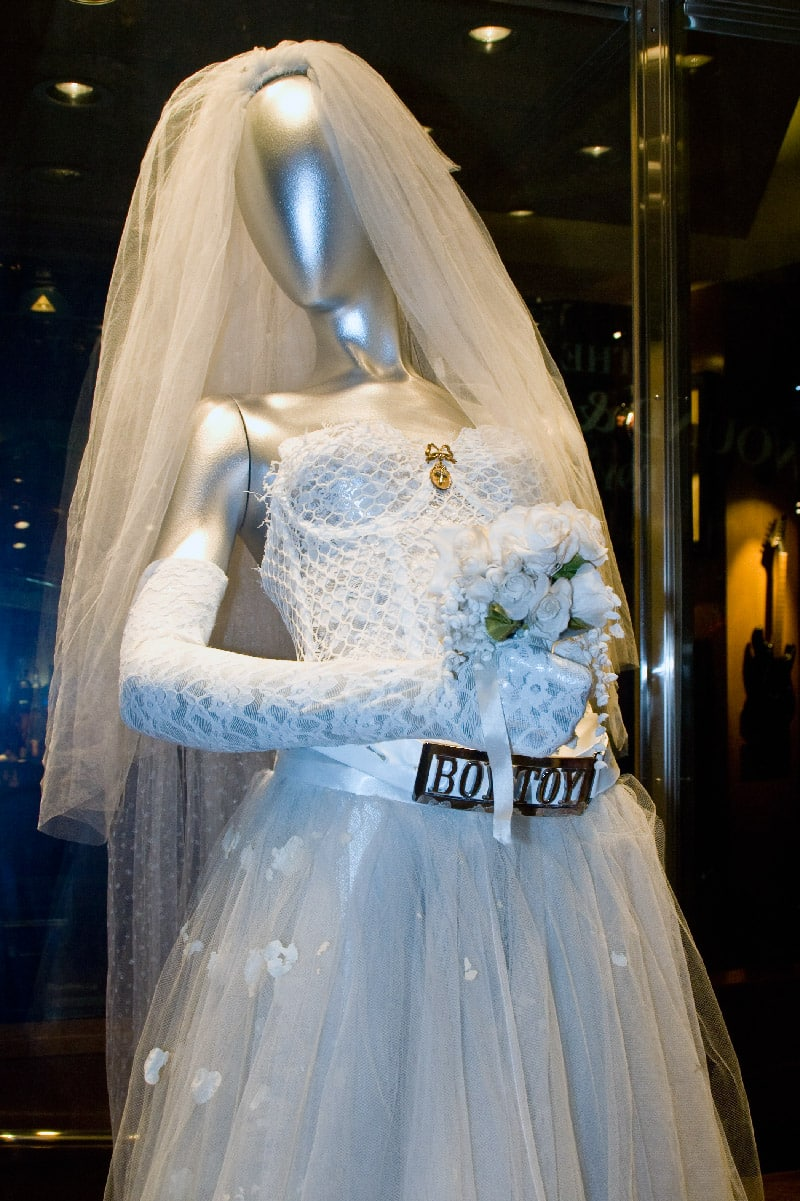 a bride can try on a wedding dress and buy it she can also try on a sample wedding dress and then have a similar one made to