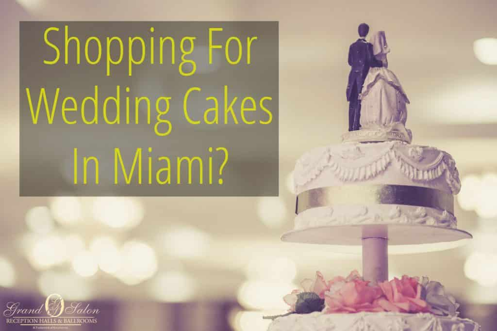 rear-view-of-wedding-cake-with-blurry-venue-in-background