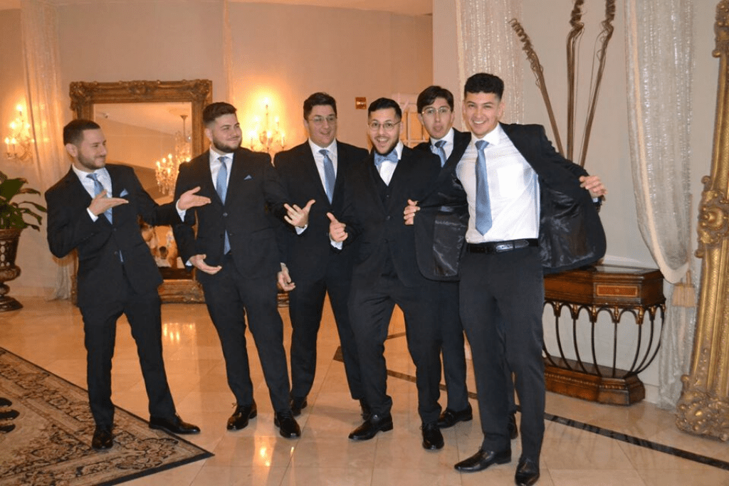 Groomsmen smiling for the camera