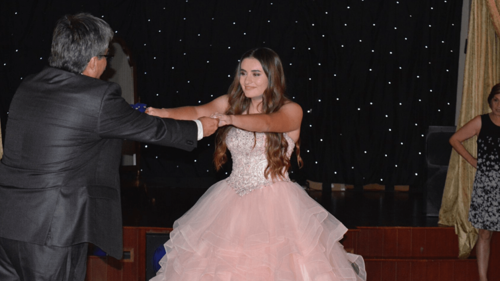 Girl dancing with her father