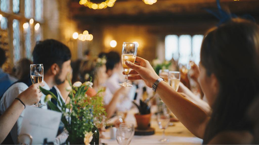 Wedding guests raising their glasses