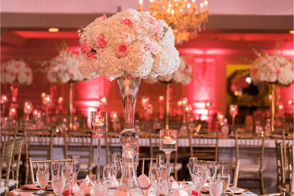 An elegantly decorated table in a ballroom