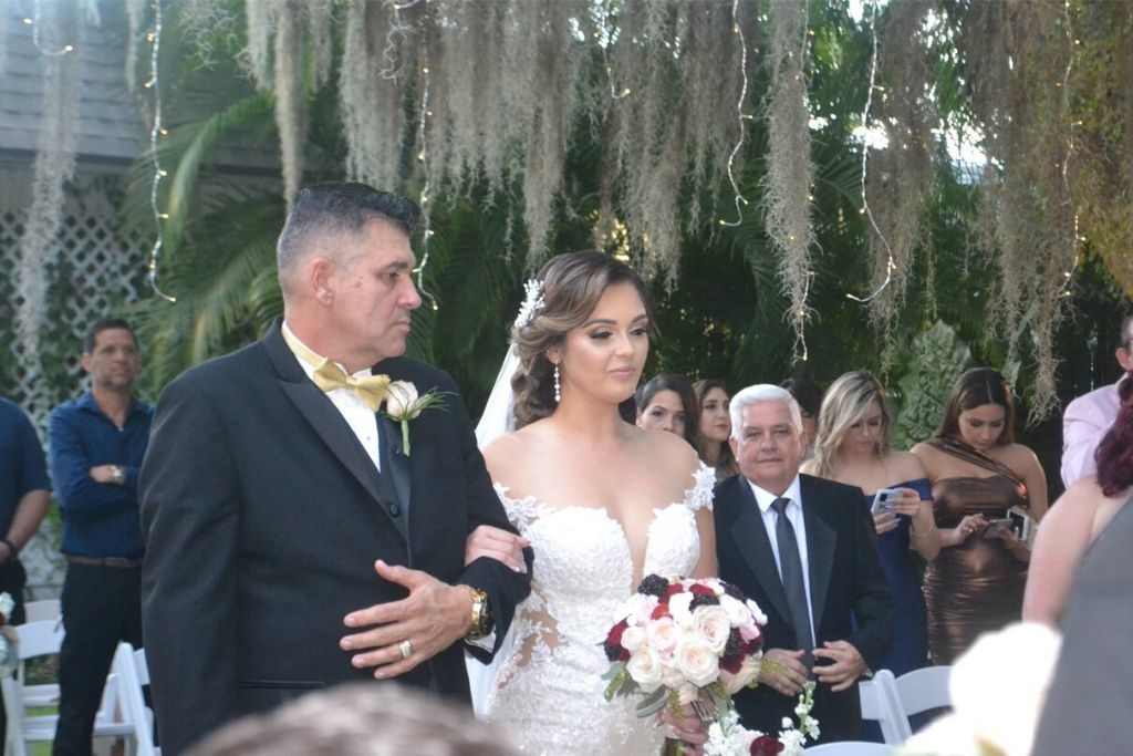 A bride and her father walking down the isle