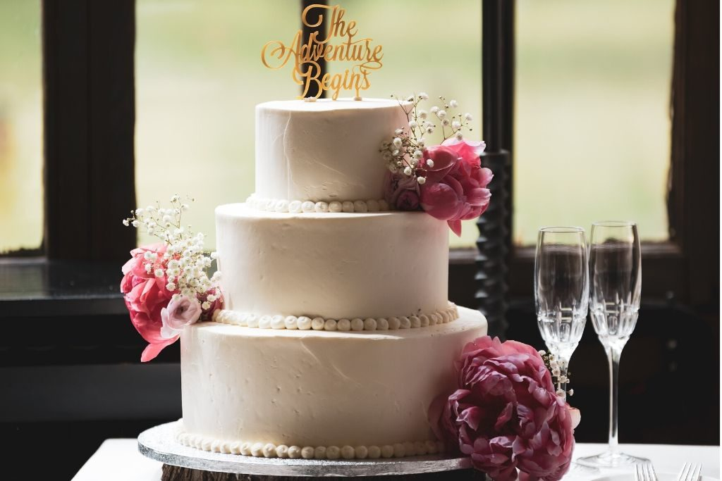 A 3-tier wedding cake with flower decor