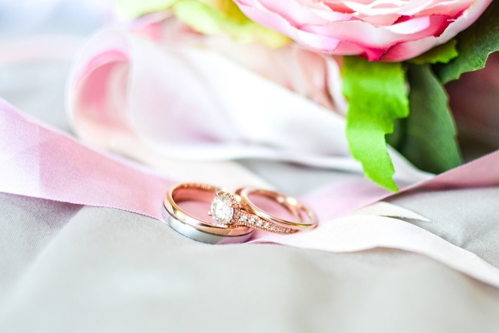 Wedding rings placed on a ribbon