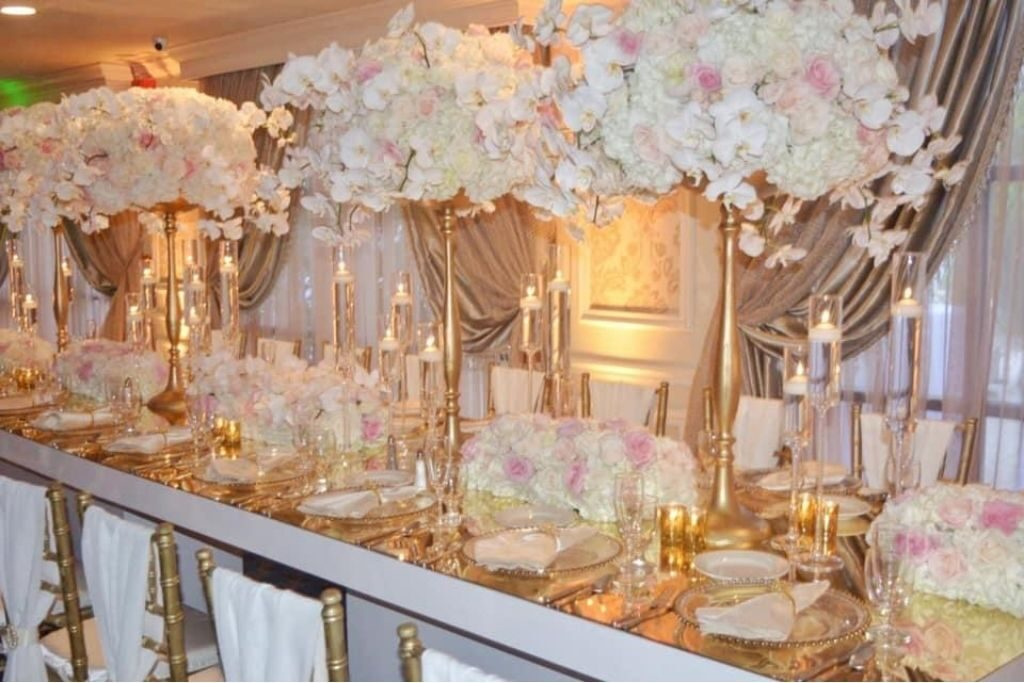 A wedding table with decorations and centerpieces