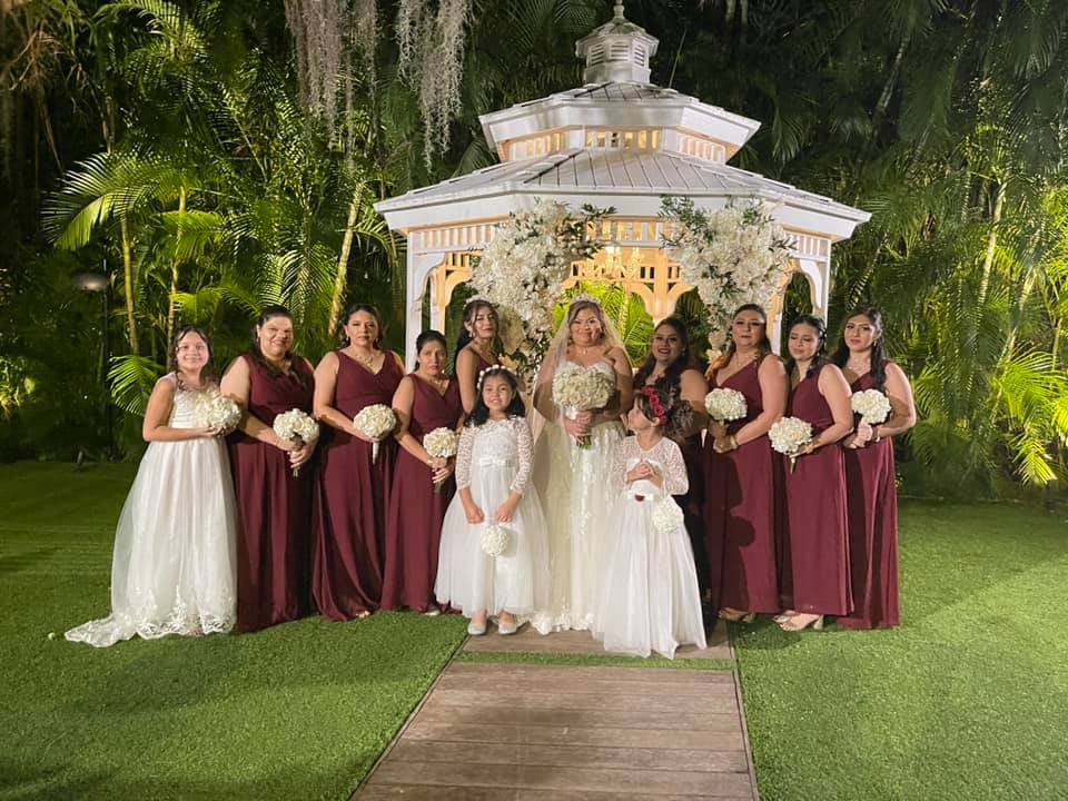A bride surrounded by bridesmaids