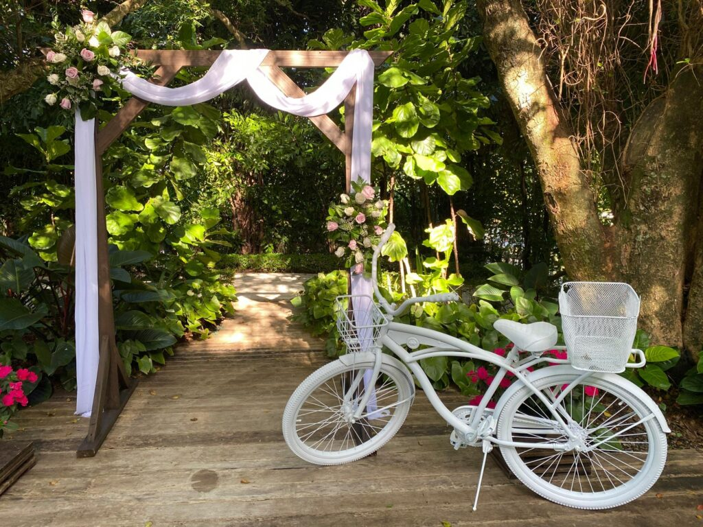 A bike with flowers outside at a venue.