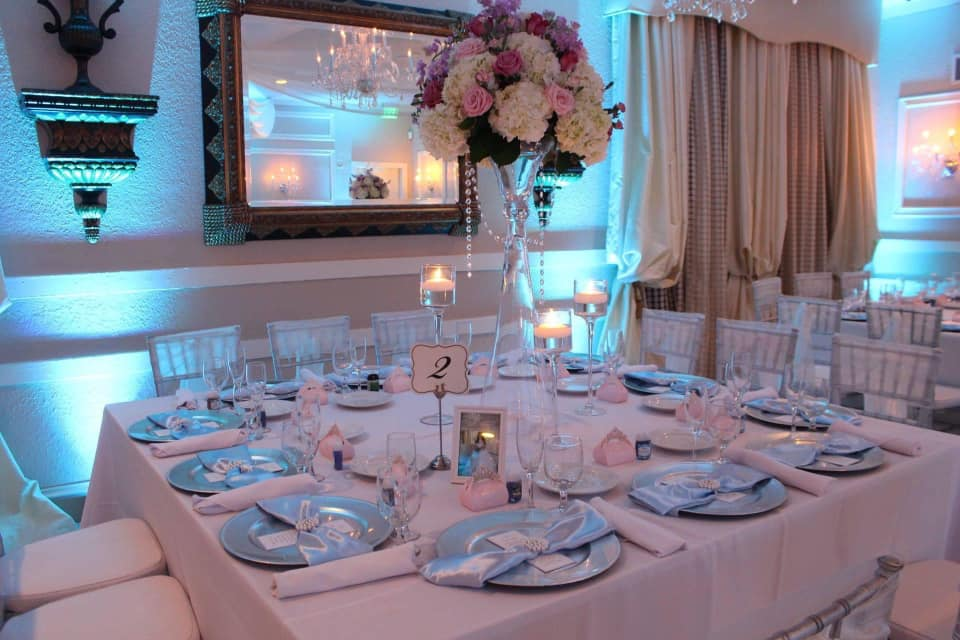 A table with flowers and table settings