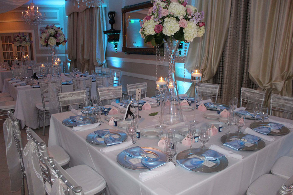 A table with decorations and place settings at an event venue.