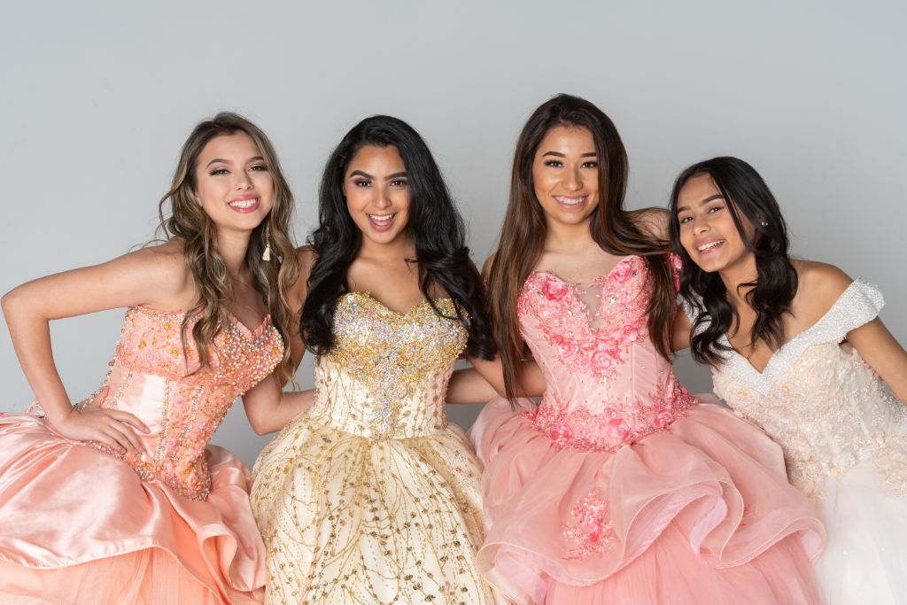 Group of young women in quinceañera dresses