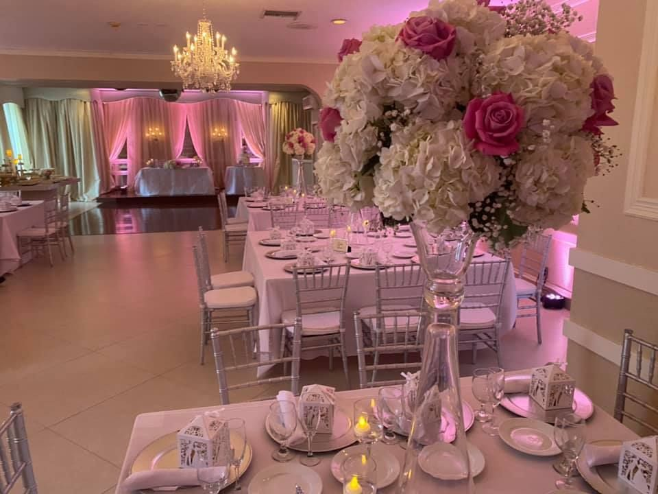 Grand Salon reception hall with flowers and tables